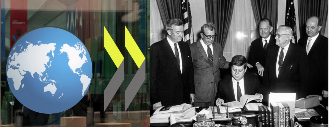 President Kennedy signs the convention creating the OECD